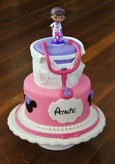 Doc McStuffins/Minnie Mouse Birthday - Cake for a special little miss who loves both Doc McStuffins AND Minnie Mouse :) Marble cake, vanilla buttercream filling, covered in fondant with fondant details and a toy Doc topper.