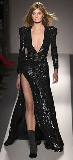 How could you not be the talk of the town in this beautiful plunging, sequined, thigh-high split gown?