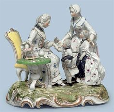 A FRANKENTHAL PORCELAIN FAMILY GROUP OF THE MOTHER'S BIRTHDAY, circa 1765. Modeled with two children offering posies to their seated mother as their nursemaid looks on, all before a table laden with a flower-filled vase, a doll and a toy trolley, on a gilt enriched rocaille base