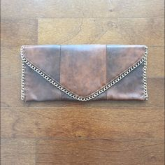 Envelope Clutch distressed leather envelope clutch. small zipper closure inside with 2 pockets n/a Accessories