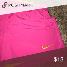 Hot pink Nike shorts In great shape. Built in spanx are yellow. Nike Shorts