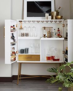 "909 curtidas, 16 comentários - CB2 (@cb2) no Instagram: ""it's friday! let's talk cocktails. link in bio shop the new CB2 Charlene White Wine Cabinet.…"""