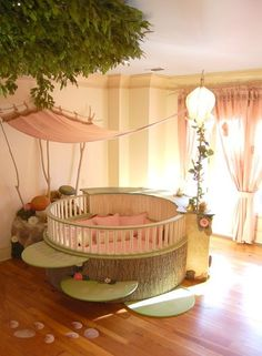 What a cute fairy room!! I wonder if the leaf steps make a difference for the first time your baby tries to climb out of the crib.