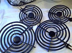 Cleaning Those Nasty Stove Burners! | One Good Thing by Jillee: Take about 1/4 cup of ammonia and seal it up with one of the burners in a large ziploc bag. Leave it outside (fumes) on a cookie sheet overnight. Wipe clean with sponge. If needed use a paste of baking soda and hydrogen peroxide to remove the last gunky bits and polish them up!