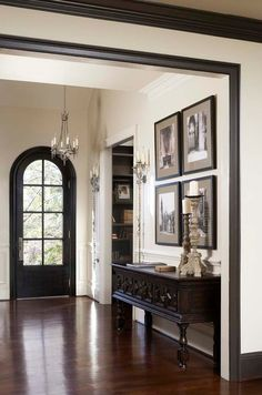 Love the dark trim mixed with the white trim..  White crown molding, dark baseboards