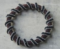 Learned a new beading stitch. Cellini Spiral. Change the size and shape of beads using the same stitch and get tons of different looks. I am working on two projects but this is one of a few samples of the stitch.