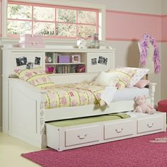 trundle daybed with bookcase. perfect for a girl to grow up with!