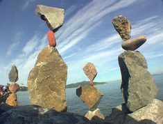 In what must be an incredible show of patience and preciseness, there are people in this weird world we all share that make a practice of balancing seemingly implacable rocks on top of each other. The result is surreal and quiet beautiful... if for nothing more than its apparent impossibility.