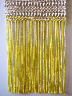 An ombre dyed macramé fringe on a wall hanging!