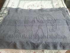 Elephant Blanket I Made For My Daughter For Christmas...Pattern In Book Called Charted Picture Afghans..by Bendy Carter...I was almost done with it when I realized I had 2 different dye lots on the yarn..I left it like that and she loves it anyways and said it was the best Christmas present ever!