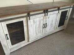 This TV console is absolutely stunning in a distressed white with a brown wood top. SO much detail in this piece and this is made out of solid pine. This has barn doors and metal mesh in the side doors. Theres 2 center shelves for lots of storage space! Very unique and this piece is hundreds more in stores, amazing price for only $650! This also comes in 2 other smaller sizes, if needed smaller. Measurements: 80 wide, 19 deep, 35 high I order wholesale from the manufacturer and have a…
