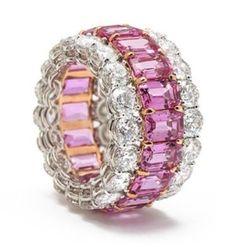A Gorgeous 12.28 Carats Emerald Cut Pink Sapphire and 8.26 Carats Diamond Platinum and 18k Pink Gold Band