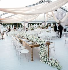 Classic white wedding with modern touches // tented wedding // Mexico wedding destination with drapes