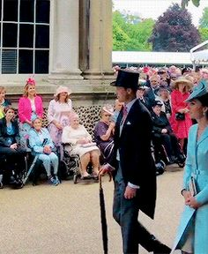 The Duchess of Cambridge joined The Queen for her first garden party of the year at Buckingham Palace, with other members of the royal family | May 16, 2017.