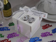 White silk square box with lid, decorated with No. 50 in silver & happy birthday ribbon