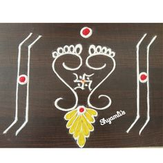 Laxmi paula rangoli Indian Rangoli Designs, Rangoli Designs Latest, Rangoli Designs Flower, Rangoli Border Designs, Rangoli Designs Images, Rangoli Designs With Dots, Beautiful Rangoli Designs, Flower Rangoli, Rangoli Borders
