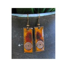 These earrings were created using a kiln firing method.  Copper is cut, filed and sanded. Fine glass powder is then layered on the copper and heated the piece with a kiln. These last two steps are repeated many times until the final look is achieved. Each of my products is an original. That´s why even the same item can be partly different from the photograph - as for the size, pattern or colour.  Dimension without hook: 1,18 x 0,44 in