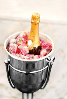 Rosebuds frozen in ice cubes to keep your champagne cold! A pricey detail--but oh so pretty!