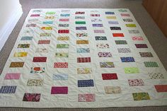 Great scrap quilt to remember all the different fabrics you've used during the year. Also a wonderful way to remember all your baby's clothing from his/her first year or baby years.