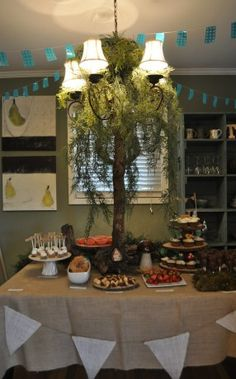 Felled tree under a mossy chandelier for a tree--brilliant. Smores bites, acorn cookies, wooden treat stand. LOVE IT!!!!