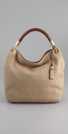 """Michael Kors """"Skorpios"""" Large woven sholder bag with braided leather handle & gold hardware."""
