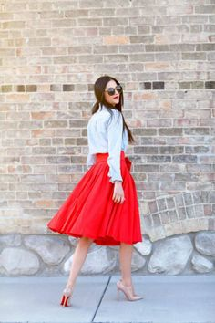 Uptown Loves the longer skirt trend. Red skirt below knee with white top. Nude shoes.