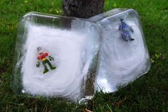 Cool summer fun- frozen batman and robin...save them by squirting the ice with water guns.