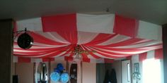 Circus Tent made out of plastic table cloths for Scarlets 4th birthday - just cut the table cloths in 3rds and use push pins to attach to the ceiling. Huge impact for only $10...... LOVED IT!!!!
