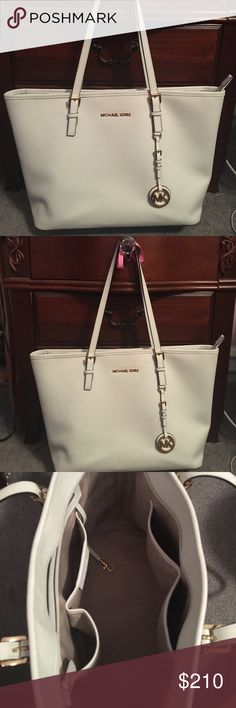 Michael Kors Jet Set Tote 100% authentic Michael Kors Tote. Beautiful condition; only used for a couple weeks, still looks new. This is the size large in white. Great size with full zipper closure and lots of pockets for storage! Michael Kors Bags Totes