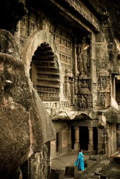 Ellora Caves - India. Building looks amazing. I like the contrast of the lady's blue dress with the colors from the building.