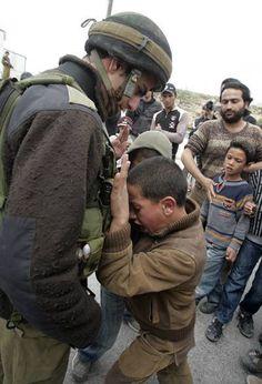 Palestinian child resisting