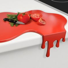 Hopefully this isn't a sign of things to come… But The Splash Cutting Board looks as though it's bleeding off your countertop. Made of plastic...and very bloody. Approximately 18″x12″ Please allow 1-2 weeks for delivery.
