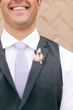 Feather Boutonniere /// Photo by Ulmer Studios, Boutonniere by Pomp & Plumage, via Project Wedding