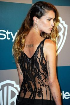 From tiny tributes to large pieces of art, see how—and where—your favorite celebs are inked.