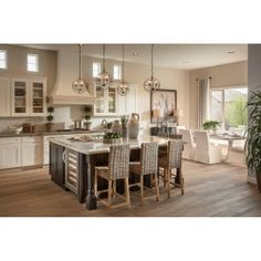 Unique way to use the mini solaris chandeliers over a large square island. #lighting #kitchen #shopcandelabra