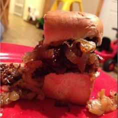 LEFT OVER SMOKED BRISKET, CHOPPED & HEATED IN BBQ SAUCE ON KING'S HAWAIIAN ROLL TOPPED WITH GRILLED ONIONS.