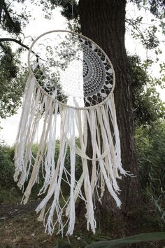 This beautiful large crochet dream catcher wall hanging is a beautiful statement of the bohemian style. The crochet part of the dream catcher took about a week to make!  This bohemian wall decor has a magnetic energy of a handmade item. It is made of crochet doily, lace, ribbons, macrame ropes and feathers.  I imagine this large dream catcher on the top of your bed to make a wonderful boho bedroom decor or in your living room to make your bohemian home feel even more mystical. This giant…