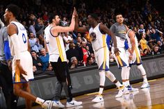 Draymond Green and Zaza Pachulia of the Golden State Warriors high five each other during the game against the Boston Celtics on March 8 2017 at...