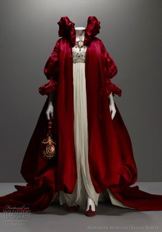 "Alexander Mcqueen #wedding #dress regal coat of red silk satin and empire waist dress of ivory silk chiffon embroidered with crystal beads from ""The Girl Who Lived in the Tree"", Fall 2008"