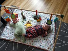 Use dowels and PVC joints to make this DIY play gym for baby. Hours of fun playtime. Twins-approved.