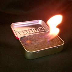 "Altoid tin alternative to sterno, cardboard & wax.  This burns fast and hot! It will last a few hours and can be hotter then sterno and more ""pocket friendly""."