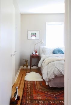 Rug On Area Ikea Semi Patternless Duvet Side Table Thats Taller Than Bed With Long Standing Lamp And Framed Art