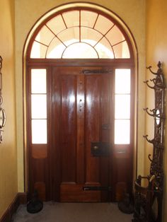 Classic fanlight and cedar two panel front door with original locks and bolts