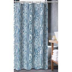 WILLOW SHOWER CURTAIN is a geometic tone on tone patern.  It comes in a aqua and adds feel of modern color into your bathroom.