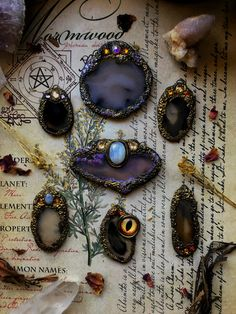 The Oracle Collection...fit with Swarovski crystals and mesmerizing agate slices, all handcrafted with golden polymer clay..• • •  #polymerclay #polymerclayjewelry #crystals #crystalhealing #swarovski #crystalsandstones #gothicfashion #handmadegifts #handmadejewelry #witchaesthetic #wicca #oracle #agate #moonstone