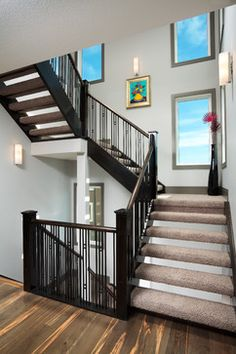 The Derelict - contemporary - staircase - calgary - Prominent Homes Ltd Contemporary stair railing with square accents.