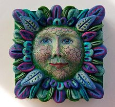 """If Flowers Had Faces""....  Isn't this gorgeous?  What a great project.  This is made from paperclay, painted in acrylics with some colored pencil and ink touches."