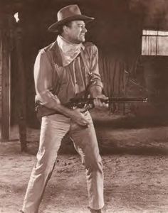 John Wayne with his signature Remington - this picture takes you to a great blog site