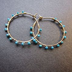Hoop earrings wrapped with turquoise beads by CalicoJunoJewelry