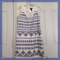 Sleeveless dress 100% polyester. Lining 95% polyester 5% spandex. White with blue embellishments and embroidery. White House Black Market Dresses